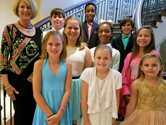 Etiquette Instructor Rhea Kirk, far left, with summer students on the grand staircase of the Capital City Club.  From left, top row: John Mark Andrews, Kevin Taylor II, Michael Matte; second row, Mallory Matte, Kendall Hardway, Anna Nekic; front, from left, Campbell Baker, Skyler Humphrey and Abbie Roblee.