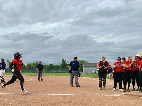 North Union's Madison Amstutz gets greeted at home plate by her teammates after her three-run home run ended the game with Bishop Ready 11-1 in five innings.