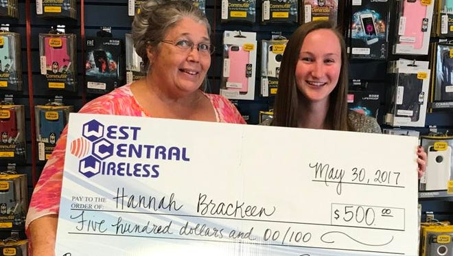 Hannah Brackeen, of Bronte High School, accepts a $500 scholarship presented by Kathie Whitworth with West Central Wireless.
