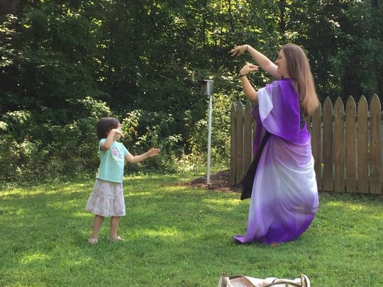 A belly dancing demonstration by Laci Tucker of Flow Motion with Maggie Cupka Head watching at last year's Live, Love, Latch.