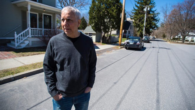 Bob Butani is concerned about a proposed apartment building near his home on Fletcher Place in Burlington on Friday, April 14, 2017.