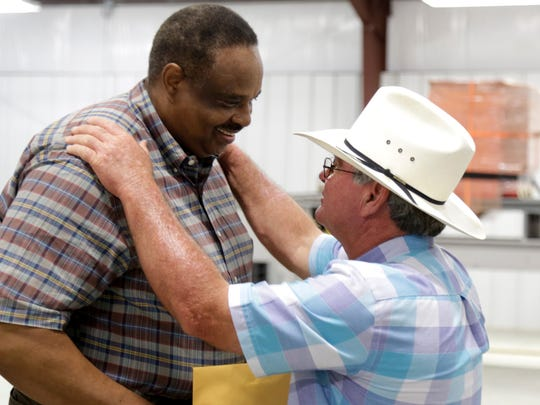 Jefferson County dairyman Ronnie Walker (right) greets U.S. Rep. Al Lawson, D-Tallahasse, before the congressman meets with constituents at a farming forum outside Monticello Thursday.