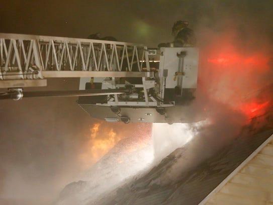 Elmira Heights firefighters battle flames Wednesday