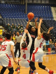 Evangel's Tiara Young gets pounded by the John Curtis