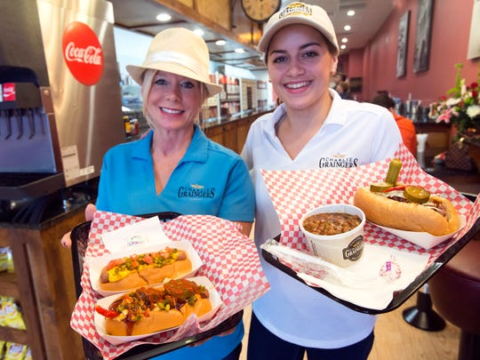 Cyndi Mastaw, left, and her daughter, Alexia Weller, right, are bringing hot dogs and smoked brisket sandwiches to the Warrington area with the opening of Charlie Graingers on Navy Blvd.