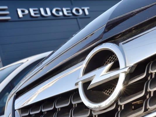 636226923688258487-AP-Germany-Opel-Peugeot-MME1.jpg