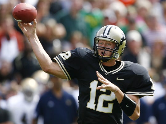 Purdue's Curtis Painter throws a pass during the Boilermakers