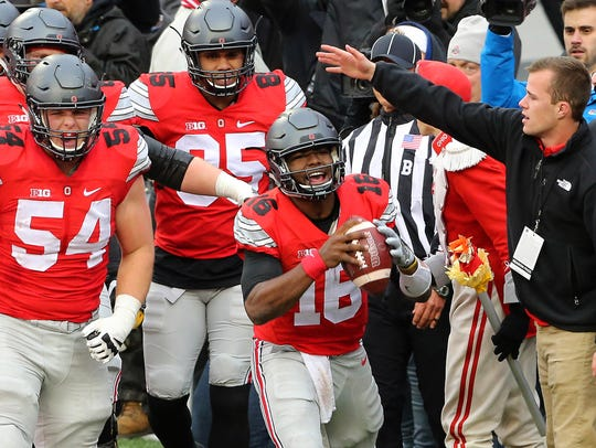 Ohio State quarterback J.T. Barrett celebrates a touchdown