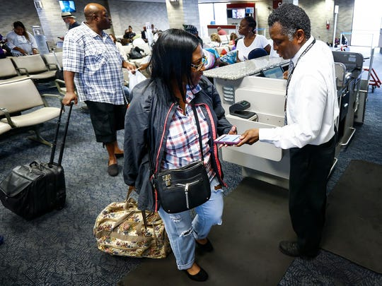 Frontier Airlines costumers board the budget airlines inaugural non-stop flight to Las Vegas at the Memphis International Airport Monday afternoon.