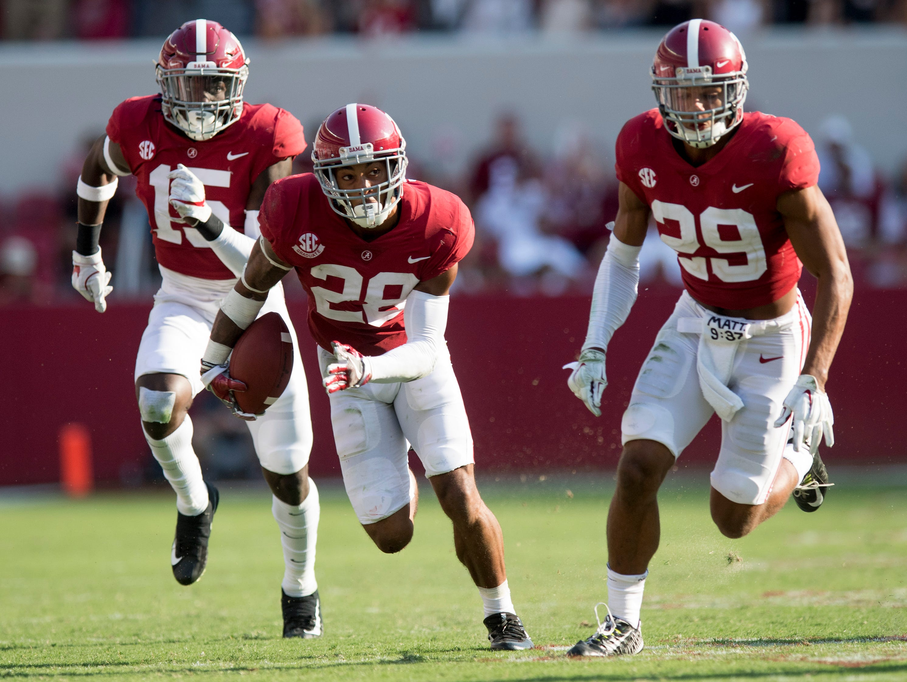 Alabama defensive back Anthony Averett (28) returns an interception against Fresno State in second half action at Bryant Denny Stadium in Tuscaloosa, Ala., on Saturday September 9, 2017. (Mickey Welsh / Montgomery Advertiser)