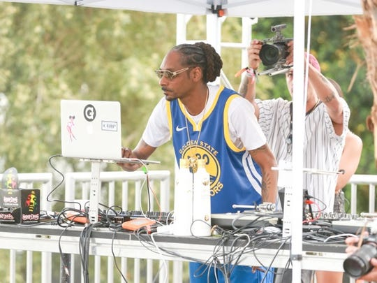 FILE - Snoop Dog on stage at the #RevolveFestival at