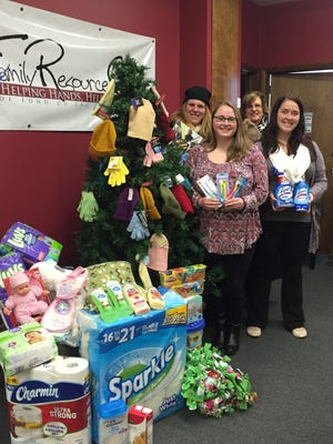 National Exchange Bank & Trust in Fond du Lac collected donations under the Christmas tree in the lobby of the 130 South Main Street location this past holiday season for the Fond du Lac Family Resource Center. Karri Klemm (back-left) and Janet Johnson (back-right) from National Exchange Bank & Trust delivered the donations to Kirsten Foster (front-left) and Natasha Frye (front-right) at the Family Resource Center.