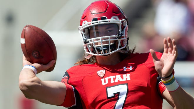 Utah quarterback Travis Wilson warms up prior to a game against Fresno State.