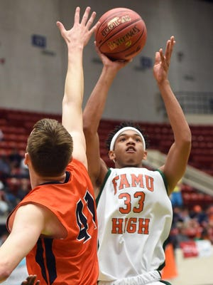FAMU DRS' Marquis Davis shoots over Bradenton Christian's J.T. Noellert during the Rattlers' 61-44 loss in the 2A state semifinals.