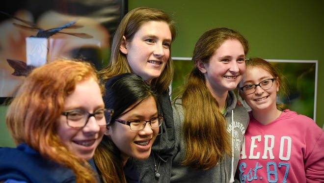 Three-time WNBA champion and Olympic basketball player Lindsay Whalen (center) posed for photos with groups of young women during a 2016 stop in St. Cloud after speaking and answering questions.