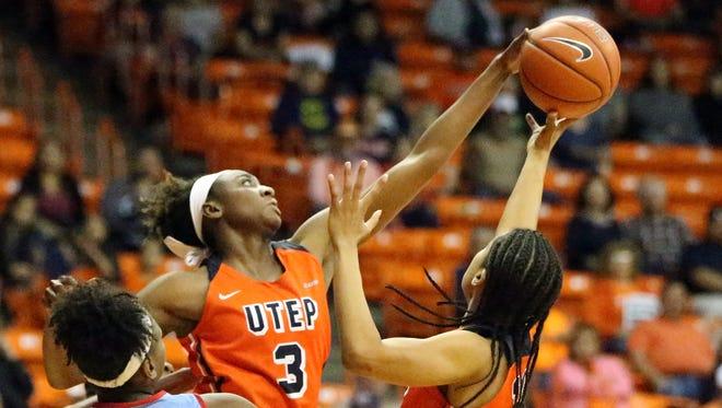 Jordan Alexander, 3, of UTEP reaches for a rebound Saturday.