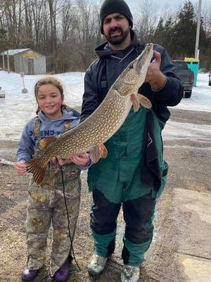 Team LoPresto poses for a picture with their contest winning great northern pike.