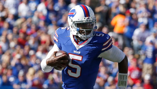 Buffalo Bills quarterback Tyrod Taylor (5) runs the ball in for a touchdown during the second half against the Arizona Cardinals at New Era Field.