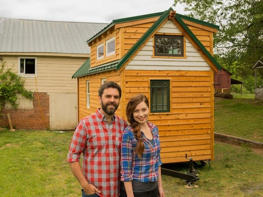 Alexis Stephens and Christian Parsons and their tiny house
