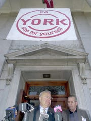 York, Pa., mayor Charlie Robertson announced Wednesday that he will be arrested Thursday for his alleged involvement in a 1969 murder of a black woman while he was a York city police officer. Robertson won the Democratic nomination for mayor on Tuesday. At right is police commissioner Herbert Grofscik. AP/York Daily Record, Bil Bowden