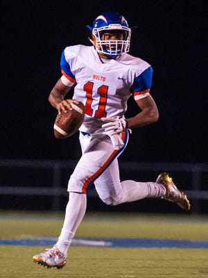Millville quarterback Elijah Nichols (11) scrambles against St. Augustine Prep at St. Augustine Prep on Friday, September 22.