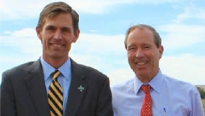 Sen. Martin Heinrich, left, stands next to Sen. Tom Udall.