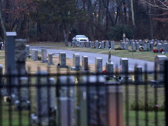 A destress man sitting inside of his Ford vehicle inside Sacred Heart Cemetery on E. Walnut Road in Vineland.  Dec. 23, 2015
