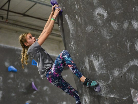Climber Tesla Mitchell competes in the New Year's Resolution