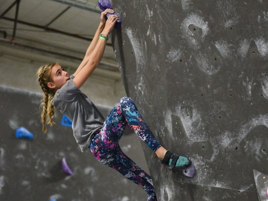 Climber Tesla Mitchell competes in the New Year's Resolution Comp on January 28, 2017 at Black Rock Bouldering Gym in Phoenix. Bouldering and climbing competitions, known as comps, are an increasingly popular part of the sport and competitive climbing will be included in the Olympic Games for the first time in 2020.