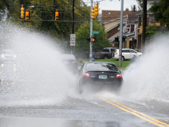 Motorists drive through floodwater on Lonyo between McGraw and Interstate 94 on Thursday in Detroit.