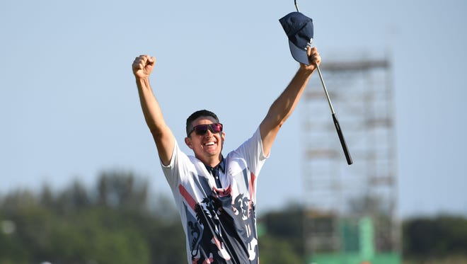 Justin Rose celebrates his Olympic gold medal.