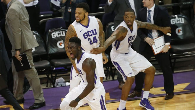 Grand Canyon University guard Fiifi Aidoo (1) celebrates after stealing the ball and scoring against San Diego State to end the game at GCU Arena in Phoenix, Ariz. December 7, 2016.