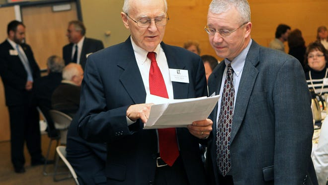 Stephen Hintz confers with the Oshkosh city manager in this 2011 file photo. Hintz has been hired to prepare a policy paper as Wausau prepares to vote in the spring on a referendum on its form of government.
