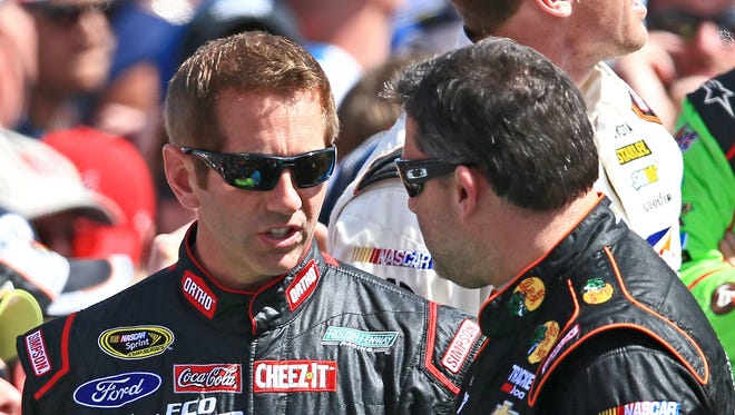 Greg Biffle, left, was with a group of riders with Tony Stewart, but did not see what led to Stewart's back injury.