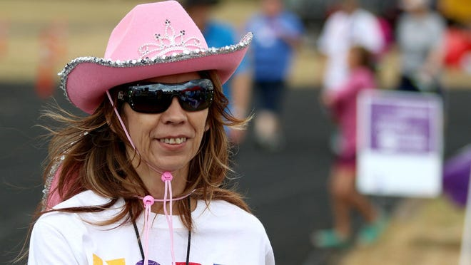 Anita Espino, on the Chemawa Braves team, walks Saturday during Relay For Life at the Chemawa Indian School