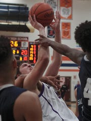 Lexington's Jonah Yaussy gets fouled hard, which led to a technical, during their District Championship game against Sandusky at Galion High School on Saturday.