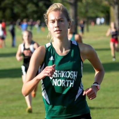 Oshkosh North's Sydney Knepfel finishes first in the