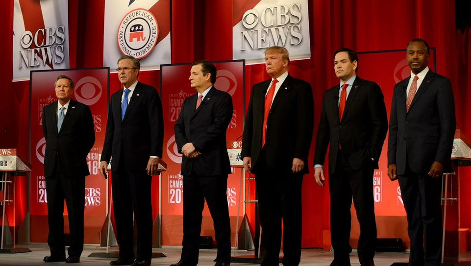 The Republican presidential candidates stand at the