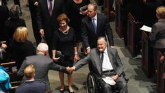 Former President George H.W. Bush, pushed by his son