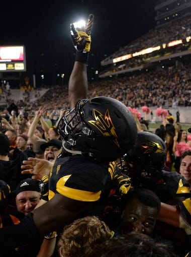 Arizona State Sun Devils players celebrate after the second half against the Washington Huskies at Sun Devil Stadium.