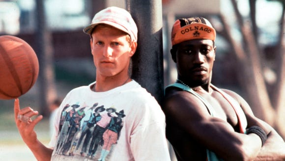 "Woody Harrelson and Wesley Snipes are a pair of rival hustlers turned teammates in ""White Men Can't Jump."""
