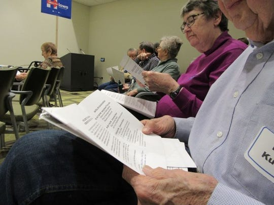 Democratic caucusgoers participate Monday in a satellite caucus site at Oaknoll Retirement Community in Iowa City.