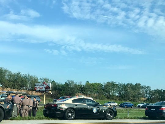 """Troopers received """"multiple reports"""" of a blue BMW driving recklessly north on I-75 near mile marker 111 about 7:30 a.m., an FHP release states."""