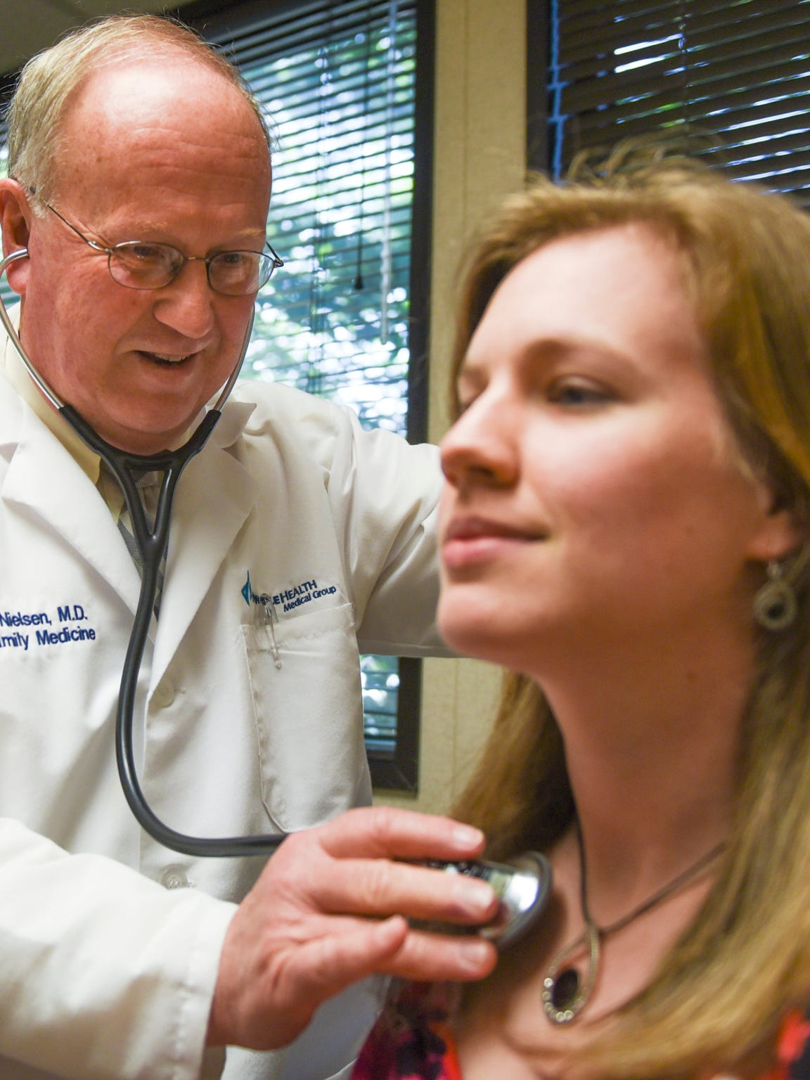 Dr. Robert Nielsen, a founding partner in Annville Family Medicine, demonstrates how to use a stethoscope on nurse practitioner Emily Brandt at the office on Tuesday, June 7, 2016.  Annville Family Medicine became part of Pinnacle Health at the beginning of 2015.