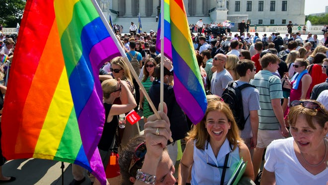 Gay rights activists gather outside the U.S. Supreme Court building in 2013