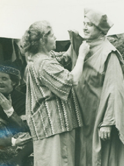 Hazel Robinson, who in 1973 founded The Montford Park Players, North Carolina's longest running Shakespeare Festival, helps actor Bill Underwood with his costume in this undated photo.