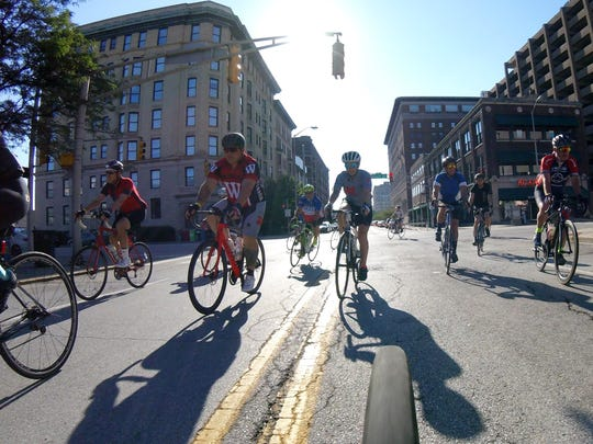 Cyclists participate in the Indy Crit Kick-Off Ride before the races begin. Cyclists of all levels converged on downtown Indianapolis, Saturday, July 8, 2017, to participate in The 8th annual Indy Criterium. Racing takes place on the 0.95 mile closed course that starts and finishes just north of Monument Circle. 100% of the event proceeds have benefited Freewheelin' Community Bikes, a local community bike shop and youth organization that serves kids in the Indianapolis community.