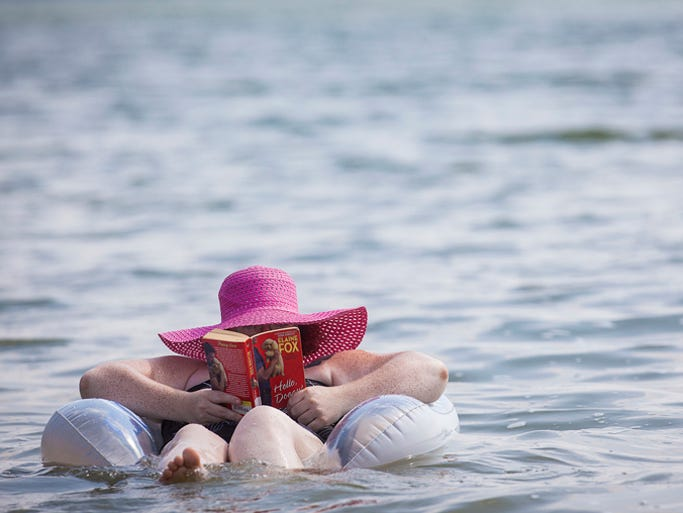 Dozens flock to Prairie Creek Reservoir Tuesday afternoon, July 22. With heat and humidity returning to Indiana, Delaware County locals turn to the water to escape the more traditional July temperatures.