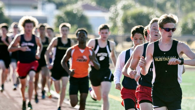 Boys run the 1600 meters during Tuesday's track meet at Merritt Island High.
