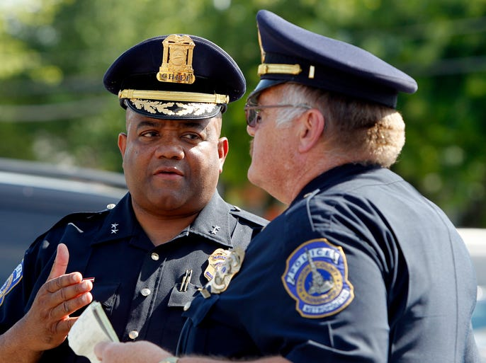 Chief of the Indianapolis Metropolitan Police Department Rick Hite, left, speaks with an IMPD Lieutenant following a press conference updating the information about the seven-victim shooting in Broad Ripple at about 2:30 a.m., in Indianapolis on Saturday, July 5, 2014.